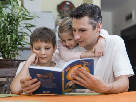 dad-with-bother-and-sister-children-reading-a-book_23-2148511416